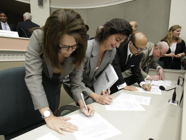 California Citizens Redistricting Commission members sign resolutions certifying the final vote for new legislative and congressional maps at the Capitol in Sacramento in 2011.