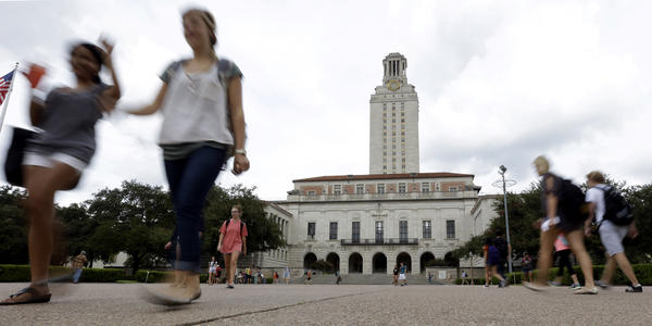 Students walk through the University of Texas, Austin, campus near the school's iconic tower.