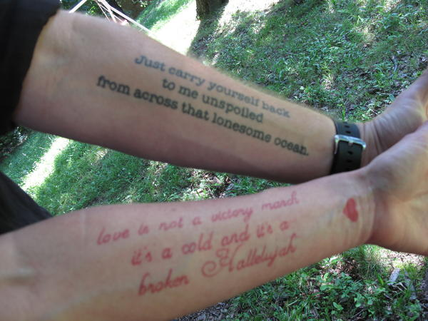 """A match made in ink heaven: Jason Isbell has the lines from Bob Dylan's """"Boots of Spanish Leather"""" on his arm, while his wife, singer-songwriter Amanda Shires, has lines from Leonard Cohen's """"Hallelujah"""" on hers."""