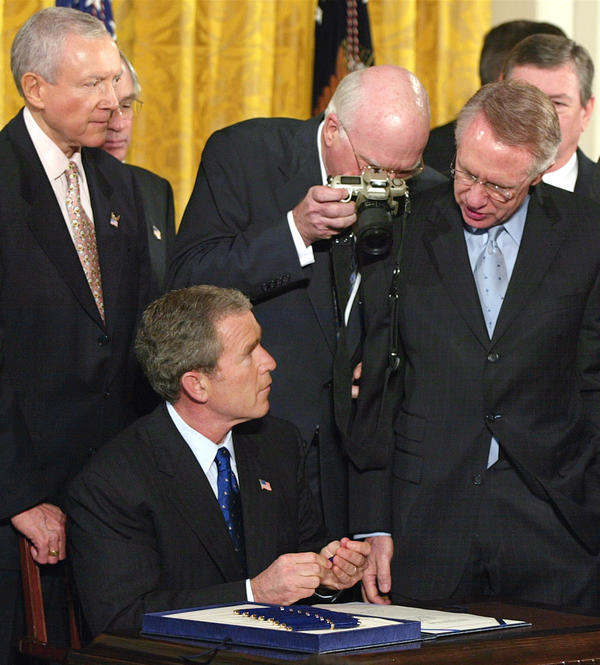 President Bush signs the Patriot Act Bill during a ceremony in the White House East Room on Oct. 26, 2001.