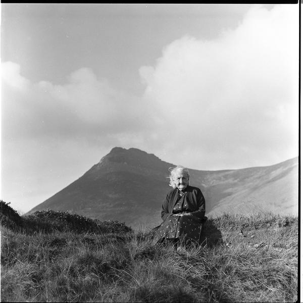 Mrs. O'Reilly sitting in a field surrounded by the Mourne Mountains in Northern Ireland, early 1970s.