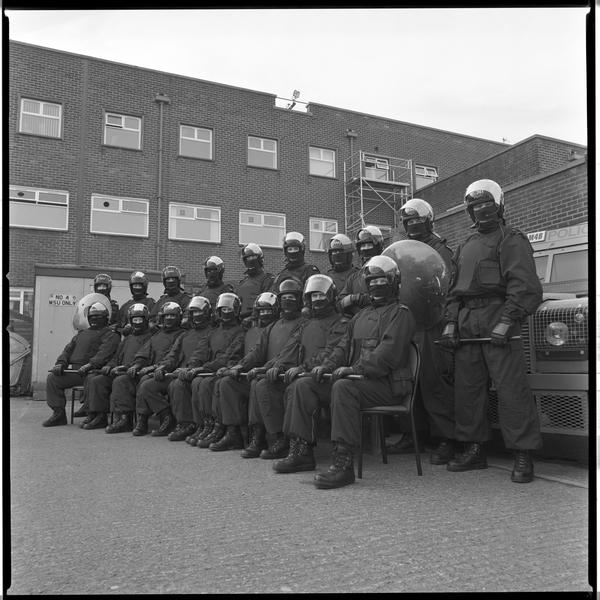 A photograph of 17 members of the RUC riot squad taken at Castlereagh RUC station, Belfast.