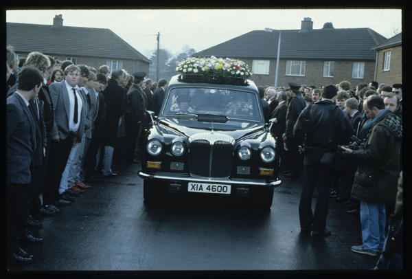 The funeral of former Ulster Defense Association leader John McMichael leaves his home in Lisburn, Northern Ireland, December 1987.