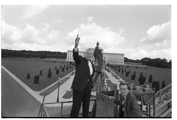 The Rev. Ian Paisley posing by the statue of Sir Edward Carson in Belfast, 1985.