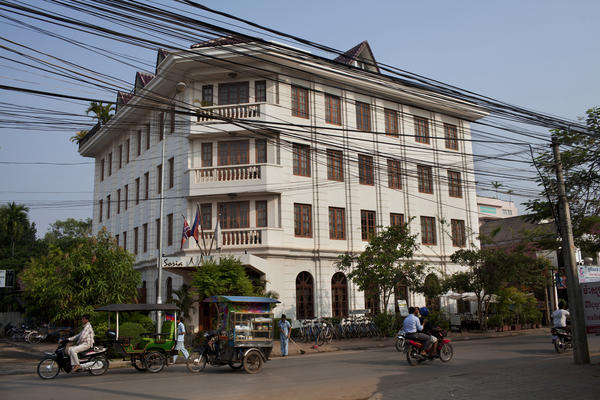 Traffic passes in front of the Soria Moria Boutique Hotel in Siem Reap, Cambodia.