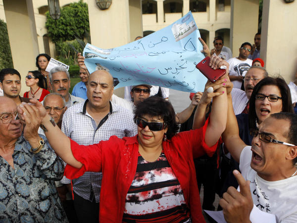 Enas Abdel-Dayem, former head of the Cairo Opera House (center), is greeted by employees and activists on May 30 as they chant anti-Muslim Brotherhood slogans during a protest demanding the resignation of Egypt's culture minister.
