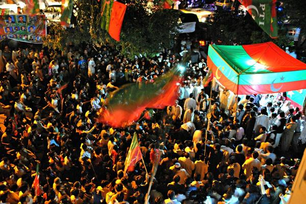 An evening election rally in Islamabad captures the enthusiasm of party supporters.