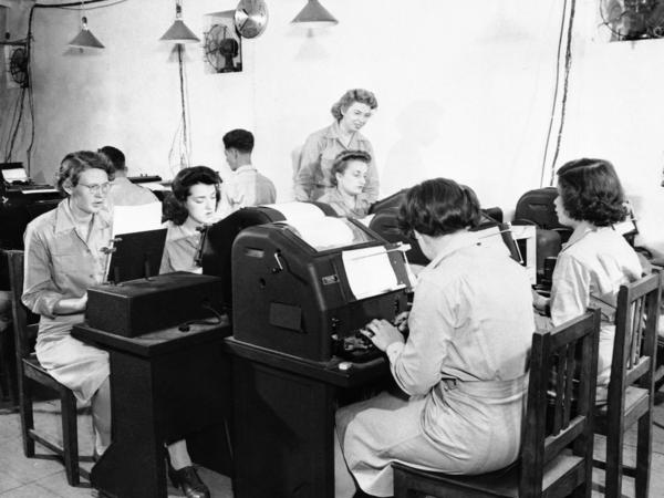 Teletype operators relay U.S. military communications in North Africa during World War II.