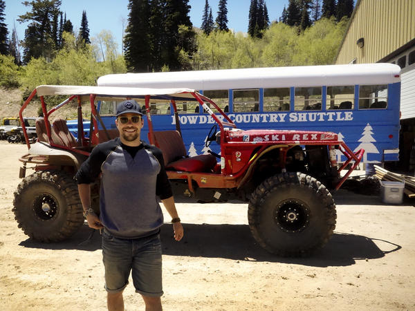 Jeff Rosenthal, co-founder of Summit, in front of Powzilla, an open-top Suburban turned rock crawler.