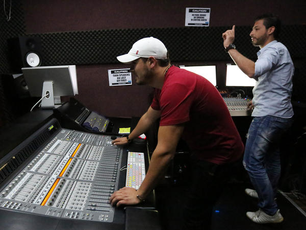 Libyan technicians work at the studio of Radio Zone in 2012, in Tripoli. The station's presenters are not afraid to speak out against militias formed in the uprising against Gadhafi, and continue to challenge the post-revolutionary government.
