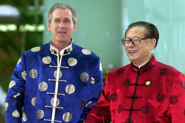 ... and none of the flair of the Asia-Pacific Economic Cooperation summit. President George W. Bush and Chinese President Jiang Zemin appeared together in traditional-style silk jackets at the APEC meeting in Shanghai, in 2001.