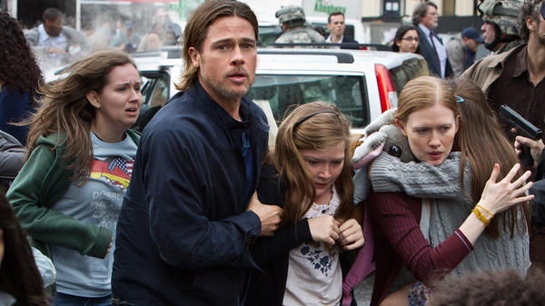 Brad Pitt is Gerry Lane, Abigail Hargrove is Rachel Lane, and Mireille Enos is Karin Lane in <em>World War Z</em>.
