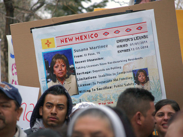 Immigrant advocates use an image of New Mexico Gov. Susana Martinez on a mock state driver's license during a 2012 rally in Santa Fe, N.M., to protest her proposal to repeal a state law that allows undocumented immigrants to obtain driver's licenses.