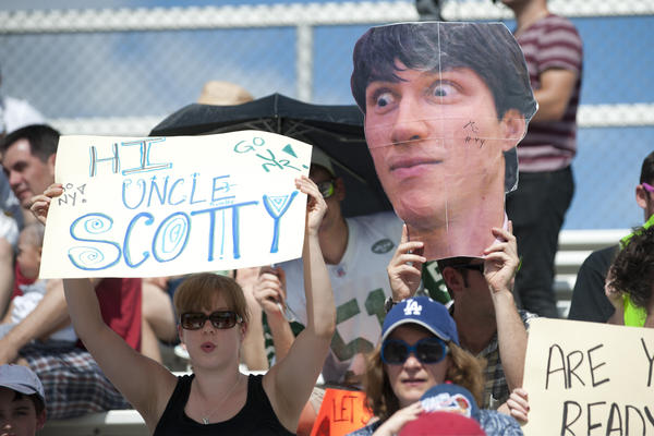 Fans hold up signs with funny slogans and players' names in support of their favorite Ultimate Frisbee players. The stands were filled primarily with DC supporters, but fans for New York were present as well.