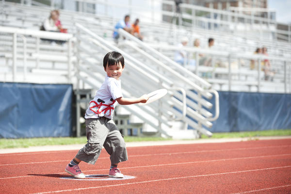 Fans of all ages showed their support for Ultimate Frisbee, including 5-year-old Justin Yi. Justin's father, Peter, has been playing Ultimate Frisbee since he was in college.