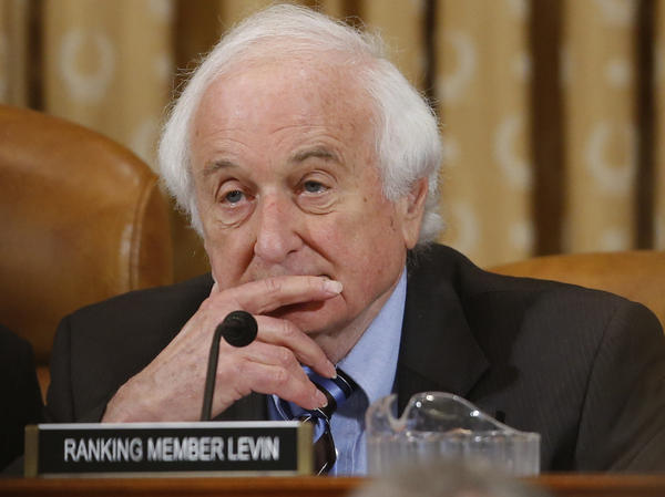 Rep. Sander Levin, D-Mich., listens as ousted IRS Chief Steve Miller and J. Russell George, Treasury inspector general for tax administration, testify during a House Ways and Means Committee hearing on May 17.