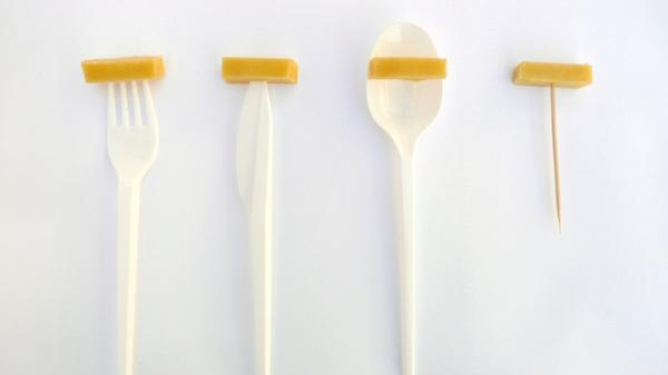 Cheese might take on a whole new flavor when you use a plastic utensil.