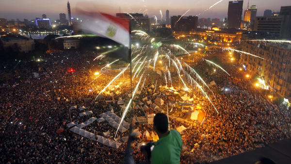 """Egyptians gather in Tahrir Square during a <a href=""""http://n.pr/16IHC0O"""">demonstration</a> against President Mohammed Morsi in Cairo on Sunday. Hundreds of thousands of Morsi opponents poured out onto the streets across much of Egypt, launching an all-out push to force him from office on the first anniversary of his inauguration."""