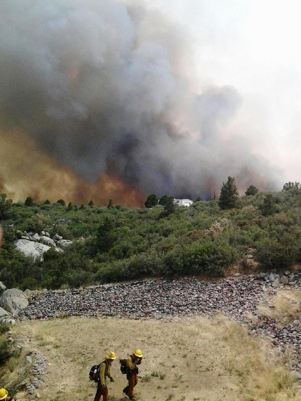 Firefighters are seen working on the Yarnell Hill fire, in this photograph from this weekend provided by the Arizona State Forestry Division. Officials say 19 firefighters died battling the blaze Sunday.
