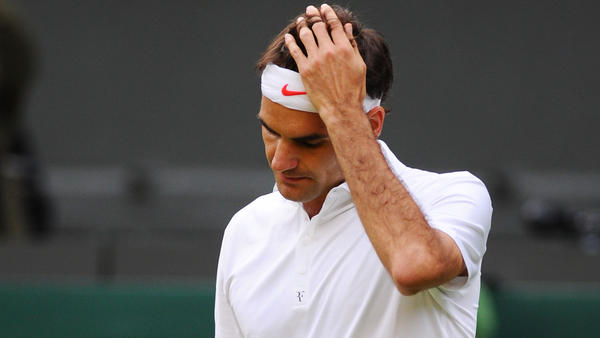 Roger Federer of Switzerland reacts during his Gentlemen's Singles second round match against Sergiy Stakhovsky of Ukraine on day three of the Wimbledon Lawn Tennis Championships at the All England Lawn Tennis and Croquet Club on June 26.
