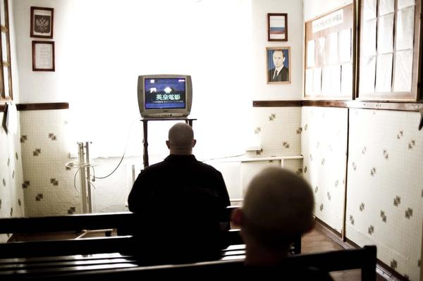 An inmate watches TV at Medical and Penal Institution Number One. Since the TB-specific health program began, rates of drug-resistant TB have dramatically decreased in Siberia's prison system, a warden says.