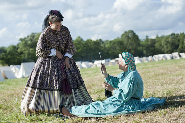 Dianne Soccio (left), of Delaware, and Adalee Flaherty, of Pennsylvania, chat in the Union Army camp. Flaherty does not limit herself to the Civil War; she also has participated in Revolutionary War, French and Indian War, and pirate war re-enactments.