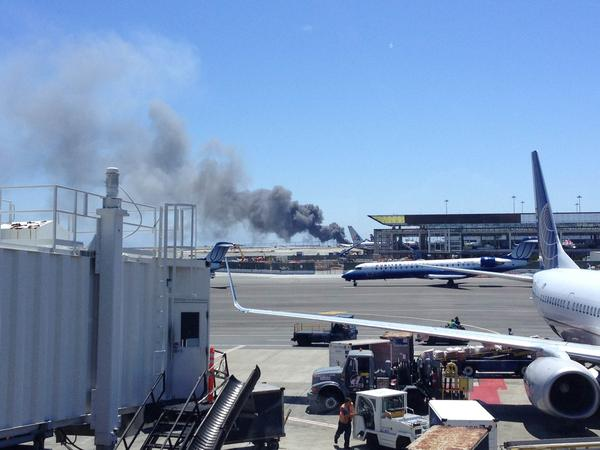 "A photo of the aircraft provided by Zach Custer. One witness inside the terminal said travelers couldn't hear the crash, but as soon as they saw the plane ""there was just a lot of uncertainty and commotion."""
