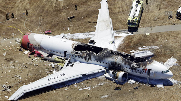 The wreckage of Asiana Flight 214, a Boeing 777 airliner, is seen after it crashed at the San Francisco International Airport Saturday. The crash-landing killed two teenage Chinese girls, the airline says.