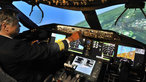 Much of the training for pilots for major airlines is conducted on sophisticated flight simulators, like this Boeing 787 simulator operated by an All Nippon Airways captain. Pilots are also trained to communicate clearly about problems they may encounter in flight.