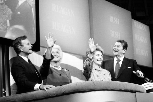 Vice President and Mrs. Bush and President and Mrs. Reagan react to support from delegates on the floor of the Dallas Convention Center at the conclusion of the final session of the Republican National Convention in Dallas on Aug. 23, 1984.