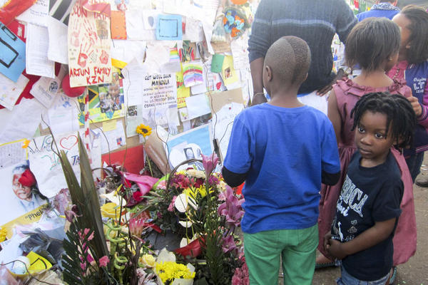 Children are among the many visitors to the memorial.