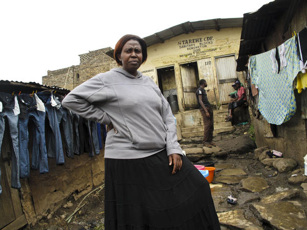 Slum mapper Emily Wangari stands outside a communal toilet in the Kiamutisya settlement of Mathare. This settlement has only four toilets for 4,000 residents. By mapping the problems, she hopes to pressure authorities to bring in more necessary services.