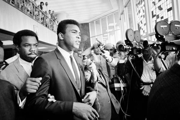 "Ali says ""no comment,"" confronted by members of the press as he leaves court for the noon recess, June 19, 1967. Ali was on trial for refusing to be inducted into the armed services."