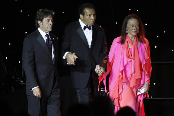 Ali is escorted onstage by his wife, Lonnie, and a personal assistant during The Muhammad Ali Celebrity Fight Night Awards XIX in Phoenix on March 23, 2013. The awards are given out to celebrities who embody the qualities of Ali and his fight to find a cure for Parkinson's disease.