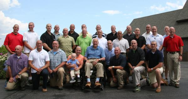 President George H.W. Bush with Patrick and the rest of his Secret Service detail, who also shaved their heads.