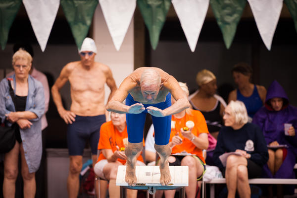 Johnston dives in during the individual medley finals for the 80-to-84 age group. Over the decades, Johnston has set world records in various age groups for older swimmers.