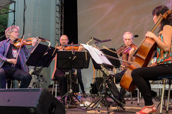 The Kronos Quartet is celebrating its 40th anniversary with an extended residency at the Lincoln Center Out of Doors Festival this week.