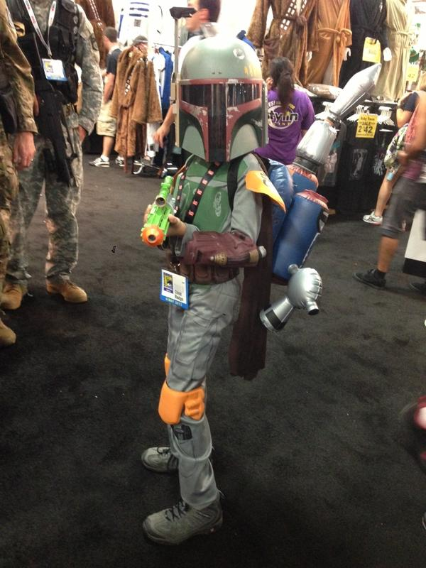 A child dresses up as <em>Star Wars' </em>Boba Fett.