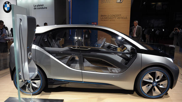 BMW's electric i3 Concept is presented before the Paris Motor Show last September. The car was officially unveiled Monday; purchasers can reportedly opt for using a gas-powered SUV several weeks each year.