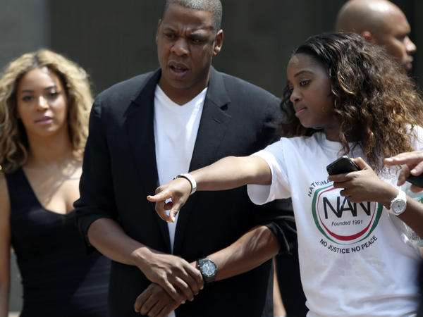 """Beyonce (left) and Jay Z arrive at a """"Justice for Trayvon"""" rally in New York earlier this month."""