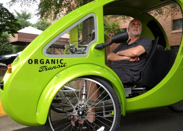 In a photo taken on July 24, ELF bike owner Mark Stewart discusses the unusual vehicle during his trip from North Carolina to Massachusetts.