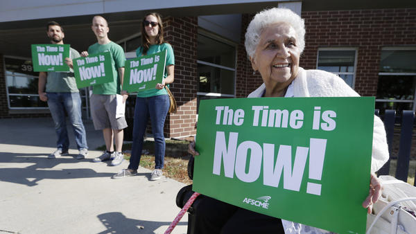 Mary Campos of Des Moines, Iowa, sits outside a forum on immigration held by senators Tom Harkin and Dick Durbin.