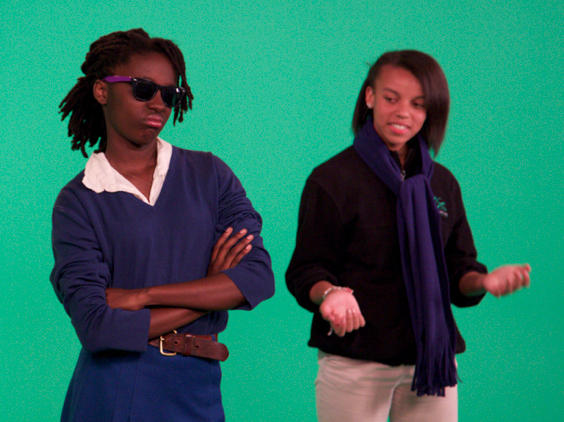 Jayda Neor and Kephra Shaw Meredith, seventh-graders from KIPP Bridge middle school in Oakland, Calif., perform a rap song about the discovery of DNA's structure in front of a green screen.