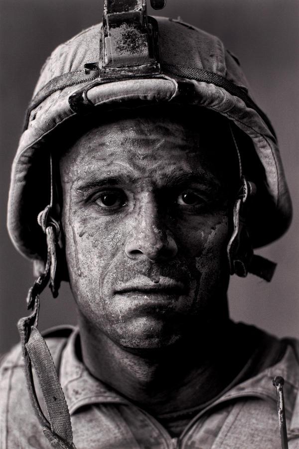 "U.S. Marine Gunnery Sgt. Carlos ""OJ"" Orjuela, 31, in Garmsir District, Helmand province, Afghanistan."