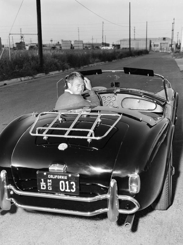 <strong>The real deal:</strong> California's new vintage car tag program would let drivers emulate icons of cool such as actor Steve McQueen, seen here in his Ford-Cobra roadster in 1963.