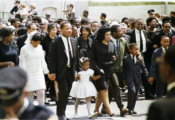 The family of slain civil rights leader Dr. Martin Luther King Jr., walk in the funeral procession in Atlanta, April 9, 1968. From left: daughter Yolanda, 12; King's brother A.D. King; daughter Bernice, 5; widow Coretta Scott King; Rev. Ralph Abernathy; sons Dexter, 7, and Martin Luther King III, 10.