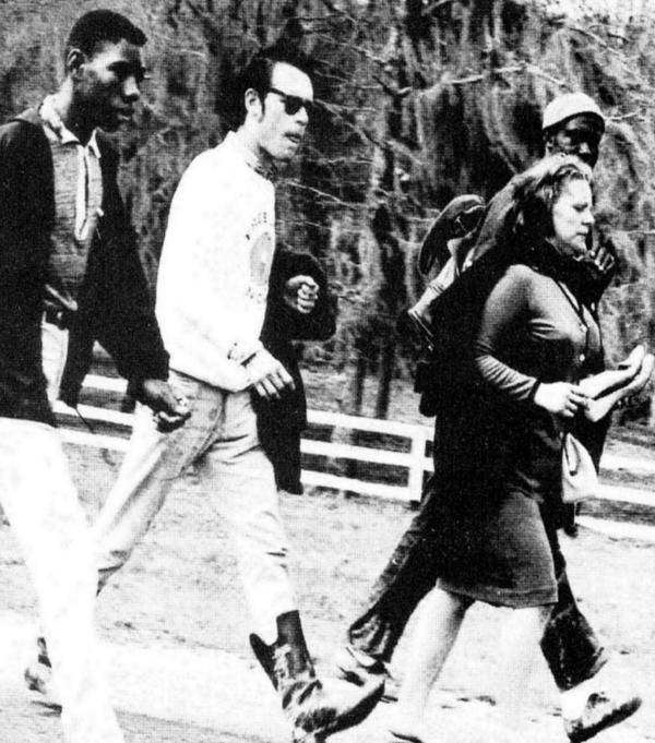 "Viola Liuzzo carries her shoes while walking with other civil rights activist before she was shot and killed in Alabama. Liuzzo-Prado says her mother walked barefoot whenever she could. ""She just hated shoes."" When her body was removed from the car she was shot in, she was barefoot."