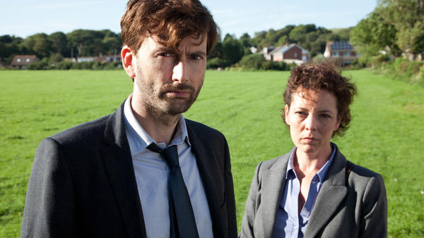 David Tennant plays Detective Inspector Alec Hardy alongside Olivia Colman as Detective Sergeant Ellie Miller, investigating the murder of a young boy in the BBC crime drama <em>Broadchurch</em>.