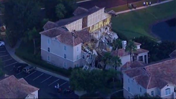 An aerial view of the Summer Bay Resort in Clermont, Fla., shows a villa that collapsed into a sinkhole Sunday night.