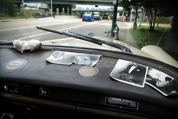 Photographs of famous Memphis musicians clutter the dash of the vintage car.